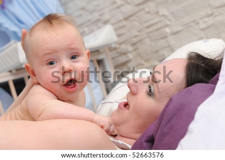 Happy infant playing with mummy