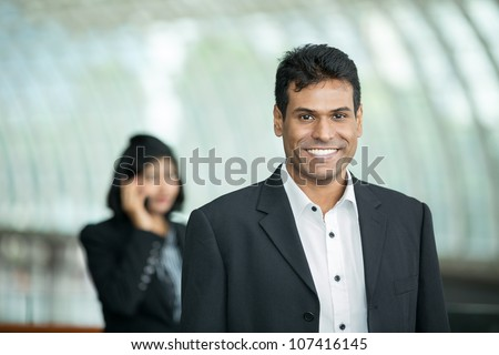 Happy Inian Business man in a corporate environment. - stock photo