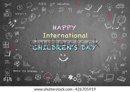 Happy international children's day text message announcement greeting with smiley face & freehand doodle chalk sketchy drawing on grunge black chalkboard background: Childrens day celebration idea