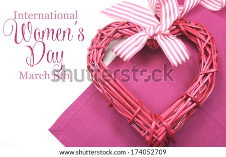 Happy International Women's Day, March 8, celebration greeting message with pink rattan cane heart and stripe ribbon. - stock photo