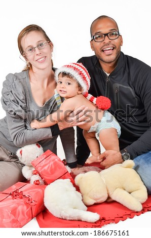 Happy interracial family celebrates Christmas - stock photo