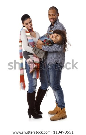 Happy interracial family with little daughter laughing. - stock photo