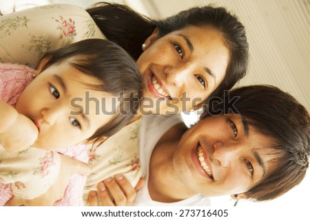 Happy japanese family portrait - stock photo