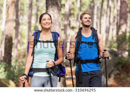 Happy joggers standing in the nature