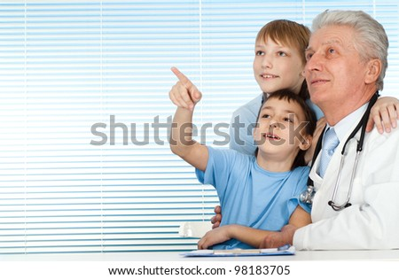 Happy joy Caucasian doctor with patients on a light background