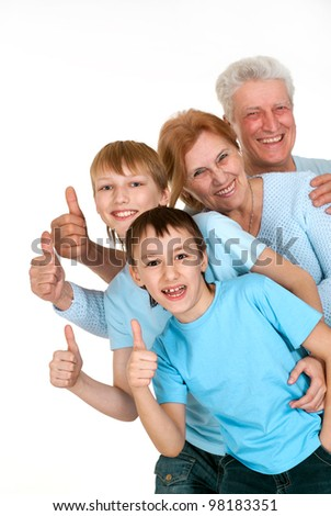 Happy joy grandparents with grandchildren fooled on a light background
