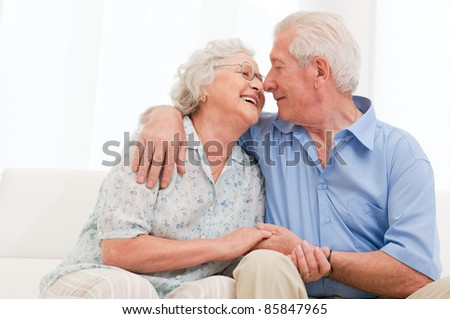 Happy joyful aged couple loving and enjoy the retirement at home - stock photo