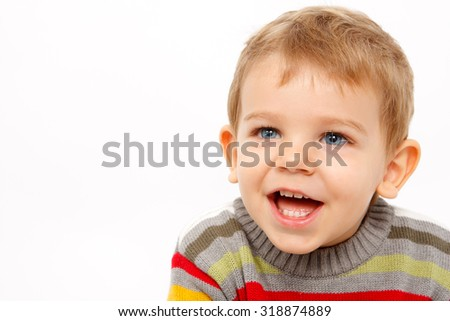 Happy joyful boy in winter clothes laughing  - stock photo