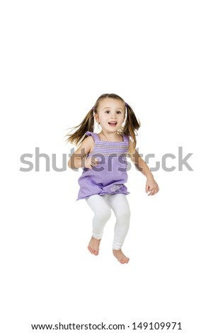 happy joyful child jumping high with real life facial expressions; isolated on white background with copy space for your text - stock photo