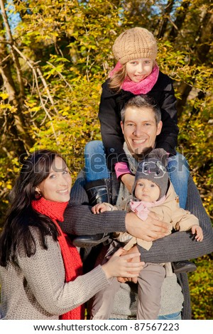 happy joyful family outside walking in park - stock photo