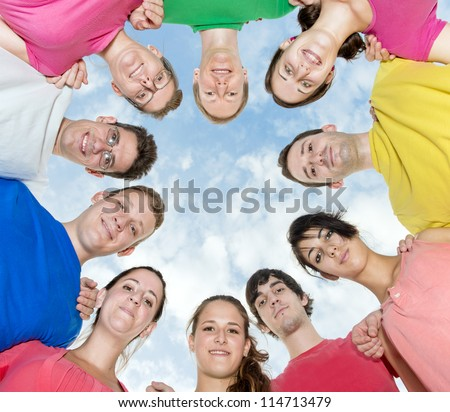 Happy joyful friends forming a circle - stock photo