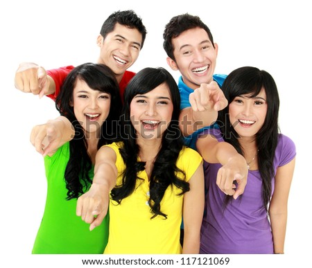 Happy joyful group of friends cheering pointing at camera - stock photo