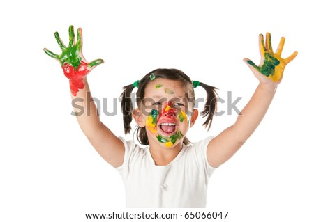 Happy joyful little girl playing with colors in her hands and face isolated on white background - stock photo