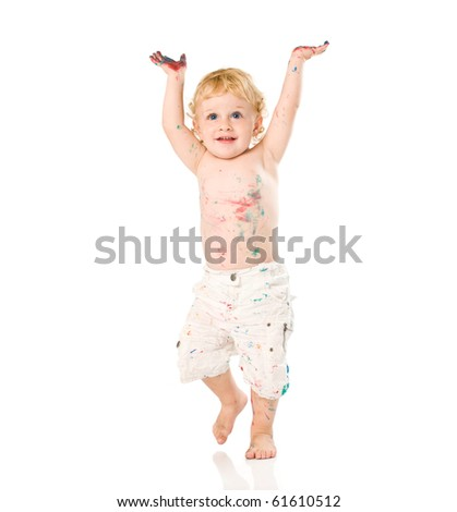 Happy jubilant beautiful child painted with colors raising arms isolated on white background - stock photo