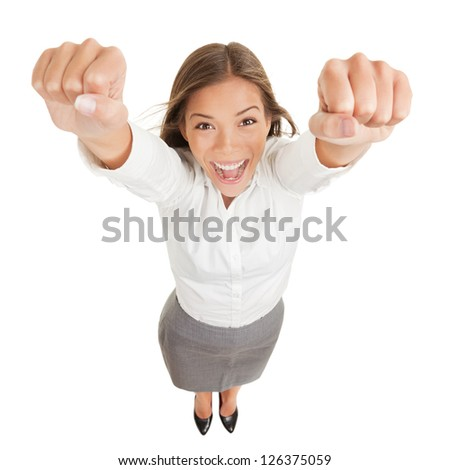 Happy jubilant you woman cheering. Fun high angle perspective of a vivacious jubilant you woman cheering and raising her clenched fists arms to the camera in her excitement isolated on white - stock photo