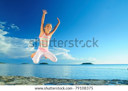 Happy jump girl and sea in the background of blue sky