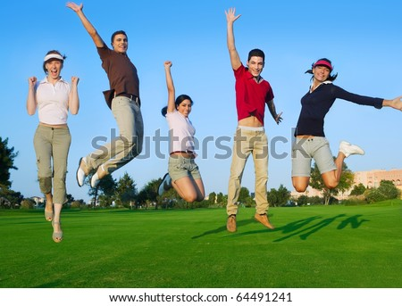 happy jump group of young people jumping outdoors grass [Photo Illustration] - stock photo