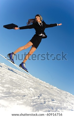happy jumping businesswoman go skiing - stock photo