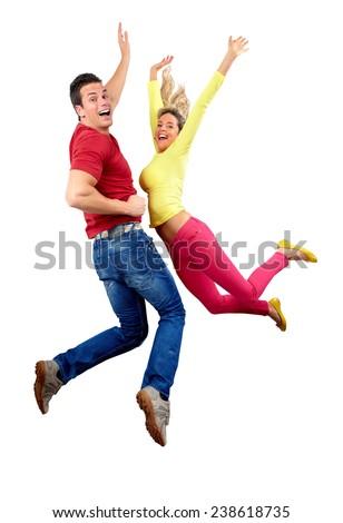 Happy jumping couple isolated white background - stock photo