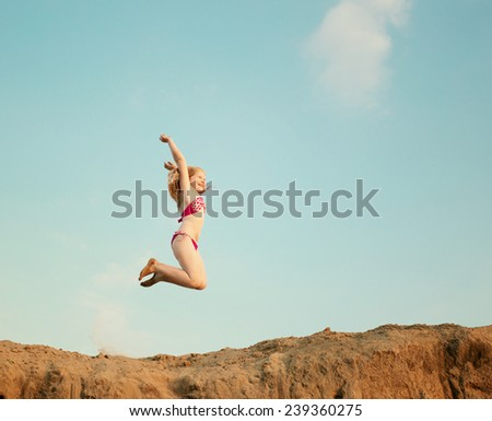 happy jumping girl - stock photo