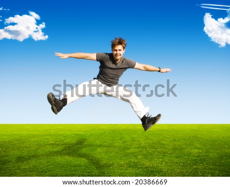 Happy jumping man on summer landscape background. - stock photo
