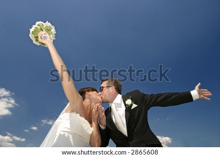 Happy, just married couple kissing.