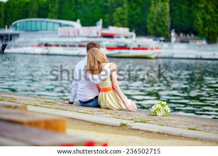 Happy just married couple on the Seine embankment in Paris  - stock photo