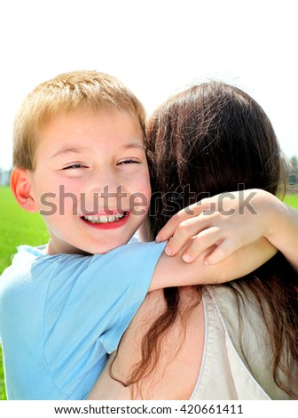 Happy Kid and Mother at the Summer Field - stock photo