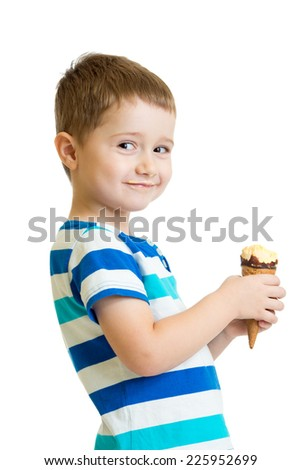 happy kid boy eating ice-cream in studio isolated - stock photo
