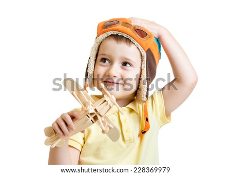 happy kid boy with airplane toy dreams to be pilot - stock photo