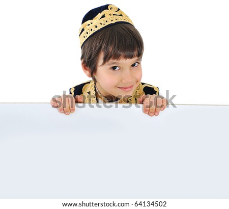 Happy kid boy with board for your message, copy space - stock photo