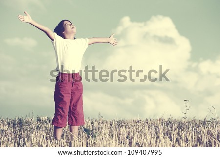 Happy kid breathing fresh air - stock photo