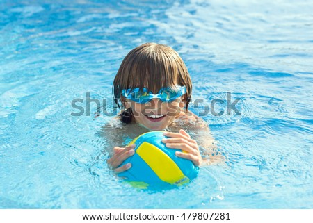 happy kid floating in the pool
