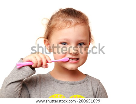 Happy kid girl brushing white teeth isolated - stock photo
