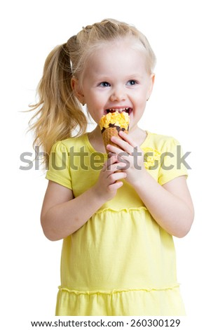 happy kid girl eating ice-cream in studio isolated - stock photo