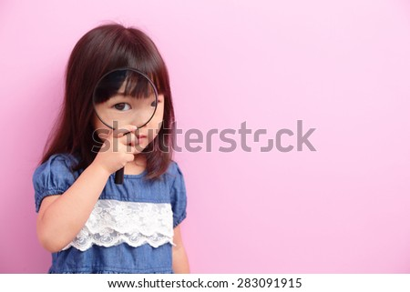 Happy kid girl smile and think something isolated on pink background, asian - stock photo
