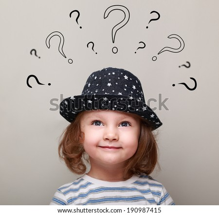 Happy kid girl thinking and looking on many question above the head - stock photo