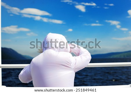 Happy kid girl traveling on ferry and see out on beauty summer day in Scotland - stock photo