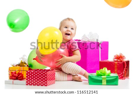 Happy kid girl with colorful balloons and gifts. Isolated on white.