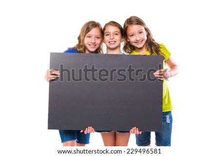 happy kid girls holding black board copyspace on white background - stock photo