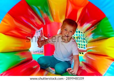 happy kid having fun on playground in kindergarten - stock photo