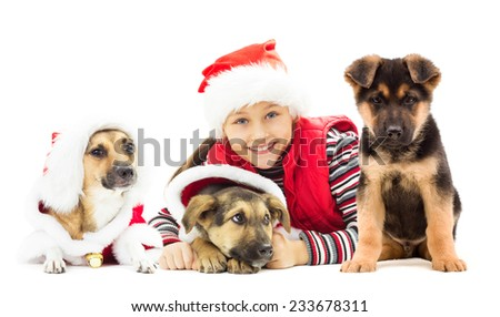 Happy kid in Christmas hat and puppy on a white background isolated
