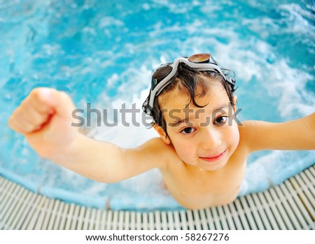 Happy kid in pool - stock photo