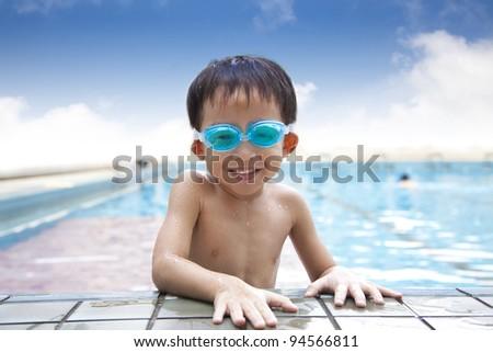 happy kid in the Swimming Pool - stock photo