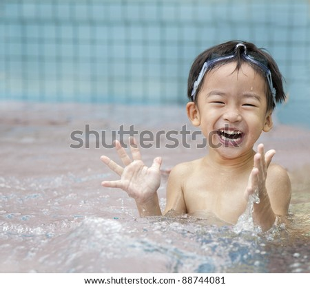 happy kid in the water - stock photo
