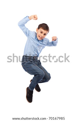 Happy kid jumping for joy, isolated on white background