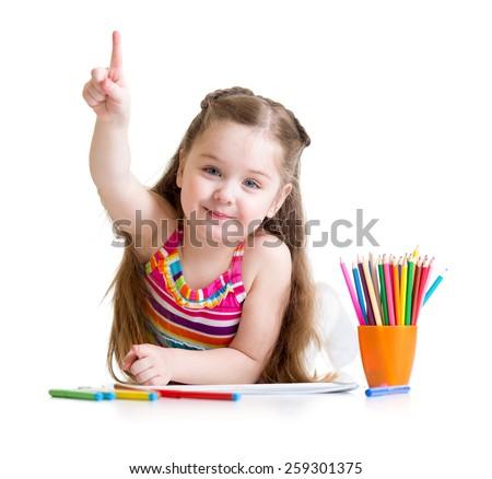 Happy kid little girl drawing with pencils in preschool - stock photo
