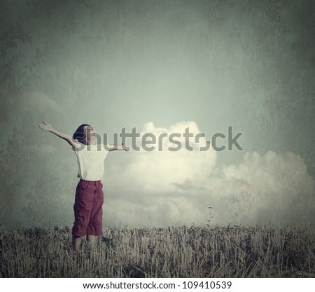 Happy kid on beautiful field in retro style old photography - stock photo