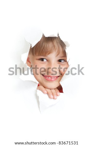 happy kid or child smiling face in torn paper hole isolated - stock photo