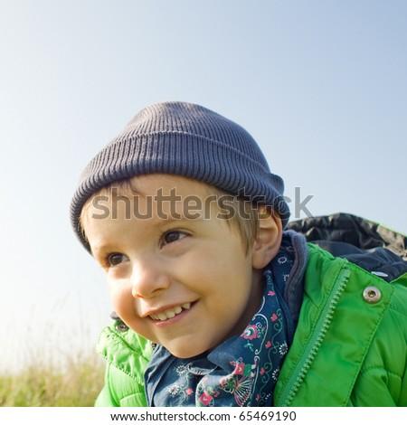 Happy kid outside. - stock photo